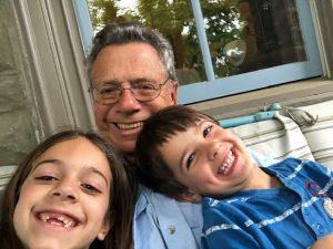 Family Visit. Three people smiling.