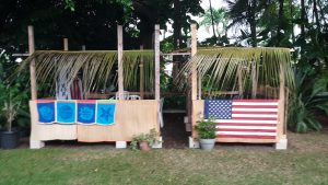 Sukkah decorations - two booths with fronds.