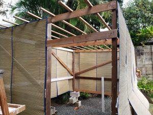 A sukkah under construction.