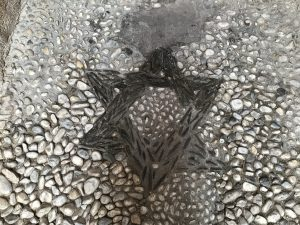 A stone path with a Star of David design