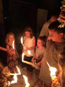 People holding havdalah candles
