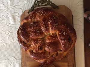 A braided round challah loaf