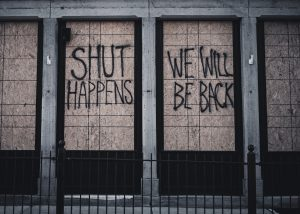 Closed store with graffiti - Shut happens we will be back