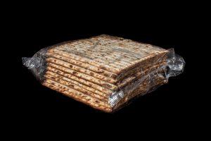 A stack of matzahs in a clear wrapper
