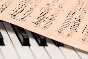 Image of a music sheet on piano keys