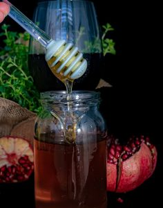 Jar of honey and pomegranates