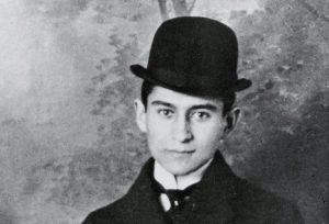 Franz Kafka wearing a bowler hat