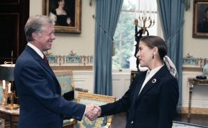 Jimmy Carter shakes hands with Ruth Bader Ginsburg