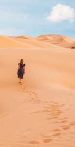 Woman walking into the desert