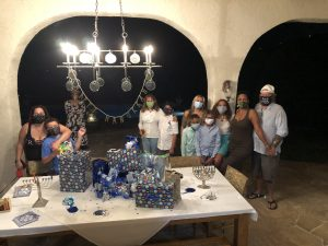 BY ROBERT LITTMAN Here is our COVID cautious Hanukkah. One daughter Tish with her family at one end. Other daughter Emma at the other and Bernice in the middle.